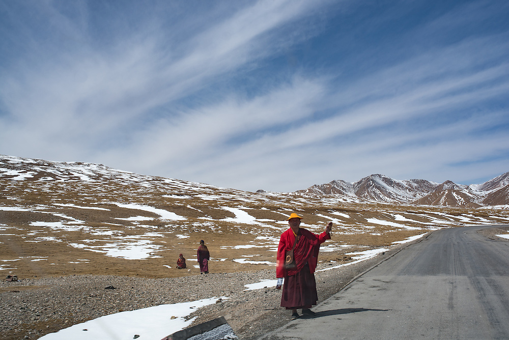 Pilgrims try to flag down cars for a ride to holy sites near Yushu prefecture Tibet (Qinghai, China).