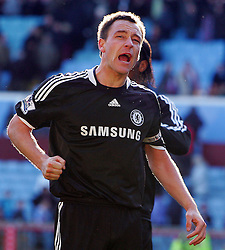 Chelsea captain John Terry celebrates victory after the Barclays Premier League match between Aston Villa and Chelsea at Villa Park on February 21, 2009 in Birmingham, England.