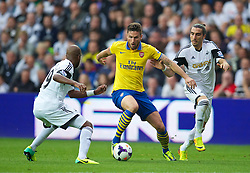 28.09.2013, Liberty Stadion, Swansea, ENG, Premier League, Swansea City vs FC Arsenal, 6. Runde, im Bild Arsenal's Oliver Giroud in action against Swansea City during the English Premier League 6th round match between Swansea City AFC and Arsenal FC at the Liberty Stadium, Swansea, Great Britain on 2013/09/28. EXPA Pictures © 2013, PhotoCredit: EXPA/ Propagandaphoto/ David Rawcliffe<br /> <br /> ***** ATTENTION - OUT OF ENG, GBR, UK *****