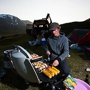 Jökull Bergmann cooking on a summer camping holliday in Hvalvatnsfjörður, Iceland.
