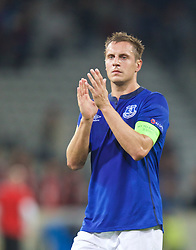 LILLE, FRANCE - Thursday, October 23, 2014: Everton's captain Phil Jagielka applauds the supporters after the goalless draw with Lille OSC during the UEFA Europa League Group H match at Stade Pierre-Mauroy. (Pic by David Rawcliffe/Propaganda)