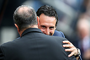 Arsenal manager Unai Emery embarces Newcastle United manager Rafael Benitez ahead of the Premier League match between Newcastle United and Arsenal at St. James's Park, Newcastle, England on 15 September 2018.