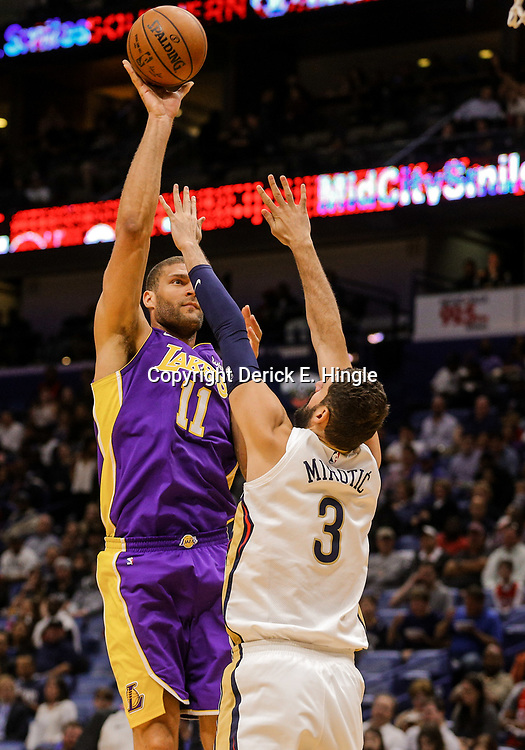 Mar 22, 2018; New Orleans, LA, USA; Los Angeles Lakers center Brook Lopez (11) shoots over New Orleans Pelicans forward Nikola Mirotic (3) during the first quarter at the Smoothie King Center. Mandatory Credit: Derick E. Hingle-USA TODAY Sports