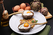 Creative breakfast for Valentine's day with eggs baked in arthicoke half.