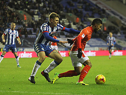 Max Power of Wigan Athletic (L) and Elias Kachunga of Huddersfield Town in action - Mandatory by-line: Jack Phillips/JMP - 02/01/2017 - FOOTBALL - DW Stadium - Wigan, England - Wigan Athletic v Huddersfield Town - Football League Championship