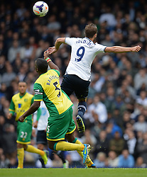 Norwich's Sébastien Bassong and Tottenham's Roberto Soldado compete for the ball  - Photo mandatory by-line: Mitchell Gunn/JMP - Tel: Mobile: 07966 386802 14/09/2013 - SPORT - FOOTBALL -  White Hart Lane - London - Tottenham Hotspur v Norwich - Barclays Premier League