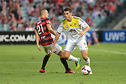 01.01.2014 Sydney, Australia. Wellingtons defender Michael Boxall and Wanderers Japanese midfielder Shinji Ono in action during the Hyundai A League game between Western Sydney Wanderers FC and Wellington Phoenix FC from the Pirtek Stadium, Parramatta. Wellington won 3-1.
