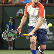 March 1, 2014, Indian Wells, California: <br /> John McEnroe hits a backhand during the McEnroe Challenge for Charity presented by Esurance in Stadium 2 at the Indian Wells Tennis Garden. <br /> (Photo by Billie Weiss/BNP Paribas Open)