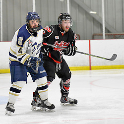 """FORT FRANCES, ON - May 1, 2015 : Central Canadian Junior """"A"""" Championship, game action between the Fort Frances Lakers and the Toronto Patriots, semi-final game of the Dudley Hewitt Cup. Tyler Currie #4 of the Toronto Patriots battles for position with Bryson Jasper #96 of the Fort Frances Lakers during the first period.<br /> (Photo by Shawn Muir / OJHL Images)"""