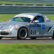 Weisberg &amp; Mitten drivers of the No. 40 Porsche Boxster speeds down the straightaway during qualifying Friday, July 22, 2011, at New Jersey Motorsports Park in Millville New Jersey.<br />