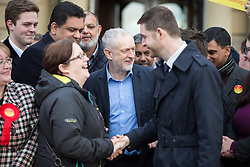 © Licensed to London News Pictures . 04/12/2015 . Oldham , UK . JEREMY CORBYN (c) joins winning candidate JIM MCMAHON on the steps of Chadderton Town Hall in Oldham for a victory rally following Labour's success in the Oldham West and Royton by-election . Photo credit : Joel Goodman/LNP