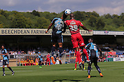 Stephane Zubar wins a header during the Sky Bet League 2 match between Wycombe Wanderers and York City at Adams Park, High Wycombe, England on 8 August 2015. Photo by Simon Davies.