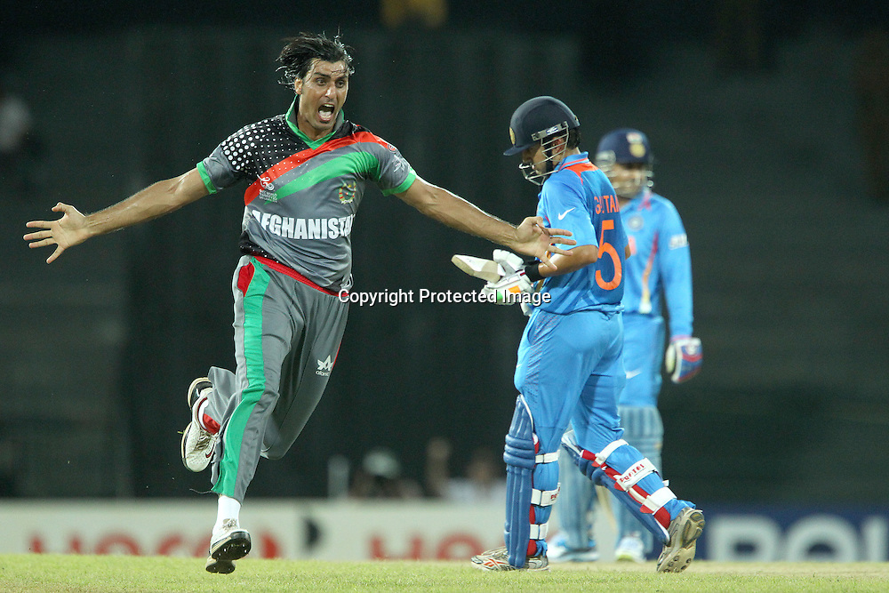 Shapur Zadran celebrates the wicket of Gautam Gambhir during the ICC World Twenty20 match between India and Afghanistan held at the Premadasa Stadium in Colombo, Sri Lanka on the 19th September 2012<br /> <br /> Photo by Ron Gaunt/SPORTZPICS