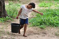 Guarani girl carrying water in Yapiroa, Izozog, Santa Cruz, Bolivia