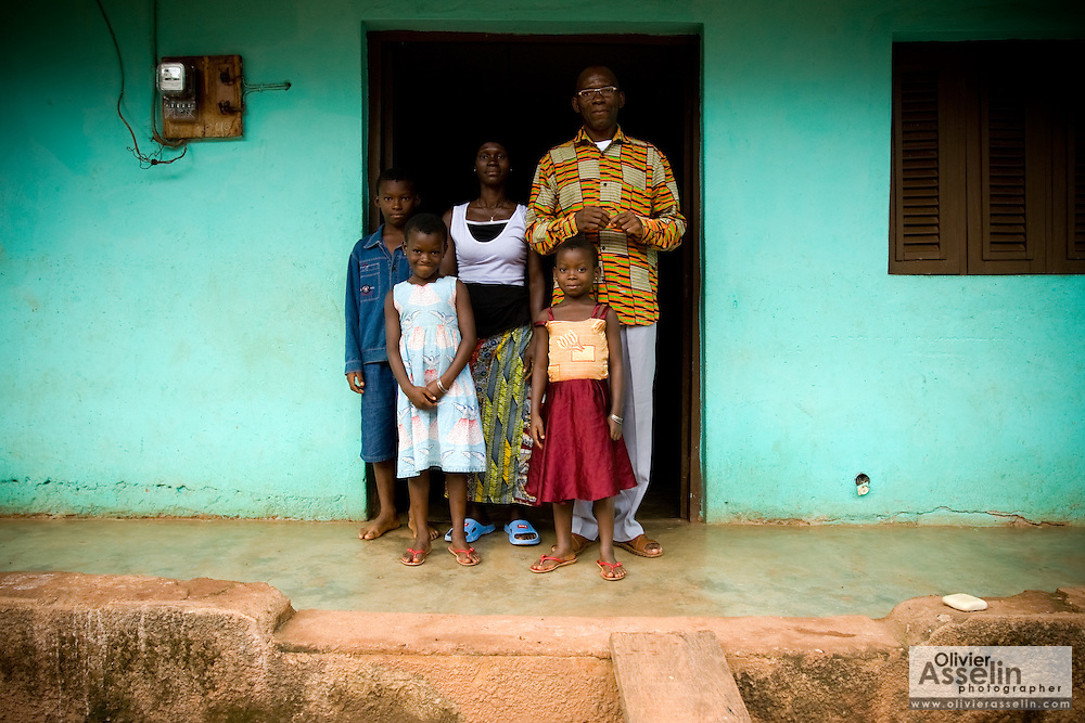 Members of the Djaha family outside their home in Dimbokro, Cote d'Ivoire on Friday June 19, 2009. From left to right Henri Joel Djaha Kouakou, 11, Solange Djaha Ahou, 8, Viviane M'Bra Affoue, 32, Alice Bienvenue Djaha Aya, 7 and Barthelemy Djaha N'Gueran, 44. Both parents and the two youngest children are HIV-positive.