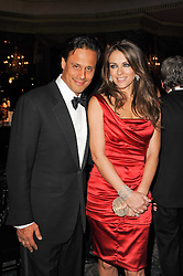 ELIZABETH HURLEY and ARUN NAYAR at the 20th annual Cartier Racing Awards - the most prestigious award ceremony within European horseracing, held at The Dorchester Hotel, Park Lane, London on 16th November 2010.