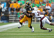 September 24, 2011: Iowa Hawkeyes wide receiver Marvin McNutt (7) loses the ball as it is hit by Louisiana Monroe Warhawks cornerback Nate Brown (26) after a catch during the third quarter of the game between the Iowa Hawkeyes and the Louisiana Monroe Warhawks at Kinnick Stadium in Iowa City, Iowa on Saturday, September 24, 2011. Iowa defeated Louisiana Monroe 45-17.