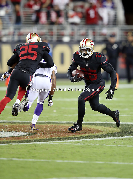 San Francisco 49ers cornerback Tramaine Brock (26) intercepts and returns a fourth quarter pass during the 2015 NFL week 1 regular season football game against the Minnesota Vikings on Monday, Sept. 14, 2015 in Santa Clara, Calif. The 49ers won the game 20-3. (©Paul Anthony Spinelli)