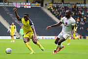 Burton Albion forward Lucas Akins and Milton Keynes Dons midfielder Hiram Boateng challenge for the ball during the EFL Sky Bet League 1 match between Milton Keynes Dons and Burton Albion at stadium:mk, Milton Keynes, England on 5 October 2019.