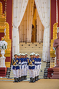"""04 FEBRUARY 2013 - PHNOM PENH, CAMBODIA:  The Cambodian Honor Guard marches out of the crematorium during the cremation of King-Father Norodom Sihanouk in Phnom Penh. Norodom Sihanouk (31 October 1922- 15 October 2012) was the King of Cambodia from 1941 to 1955 and again from 1993 to 2004. He was the effective ruler of Cambodia from 1953 to 1970. After his second abdication in 2004, he was given the honorific of """"The King-Father of Cambodia."""" Sihanouk died in Beijing, China, where he was receiving medical care, on Oct. 15, 2012.   PHOTO BY JACK KURTZ"""