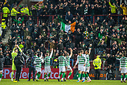 The Celtic players salute the travelling fans after the final whistle of the Ladbrokes Scottish Premiership match between Heart of Midlothian FC and Celtic FC at Tynecastle Park, Edinburgh, Scotland on 18 December 2019.