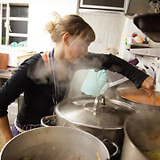 Lucie Galand, head chef at NLAH. North London Action for the Homeless cookes up a three course meal for a hundred homeless men and women in Stoke Newington, London. Every Monday luch time and Wednesday evening the charity serves up a hundred meals as well as a couple of hours of respite from the streets which in November are getting very cold and wet. All the food is donated and sourced locally and most of the staff are volunteers and have been with the charity for years.