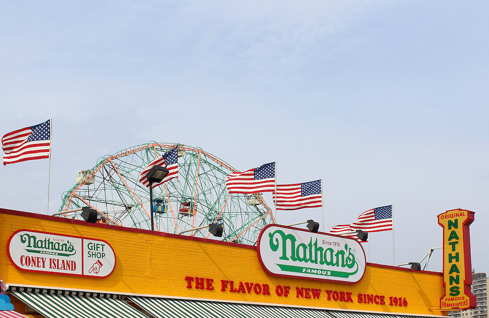 NEW YORK - SEPTEMBER 01: The Nathan's sign on September 01, 2013 in Coney Island, NY. Nathan's Famous, Inc. (NASDAQ: NATH) is a company that operates a chain of U.S.-based restaurants specializing in hot dogs.