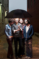 #17 Don't Get Lonesome<br /> &lt;br&gt;<br /> Ha Ha Tonka, Band<br /> &lt;P&gt;<br /> Just prior to performing their first show together in over six weeks, the Guthrie-inspired band was happy to huddle together for a photo in the alley behind the venue.