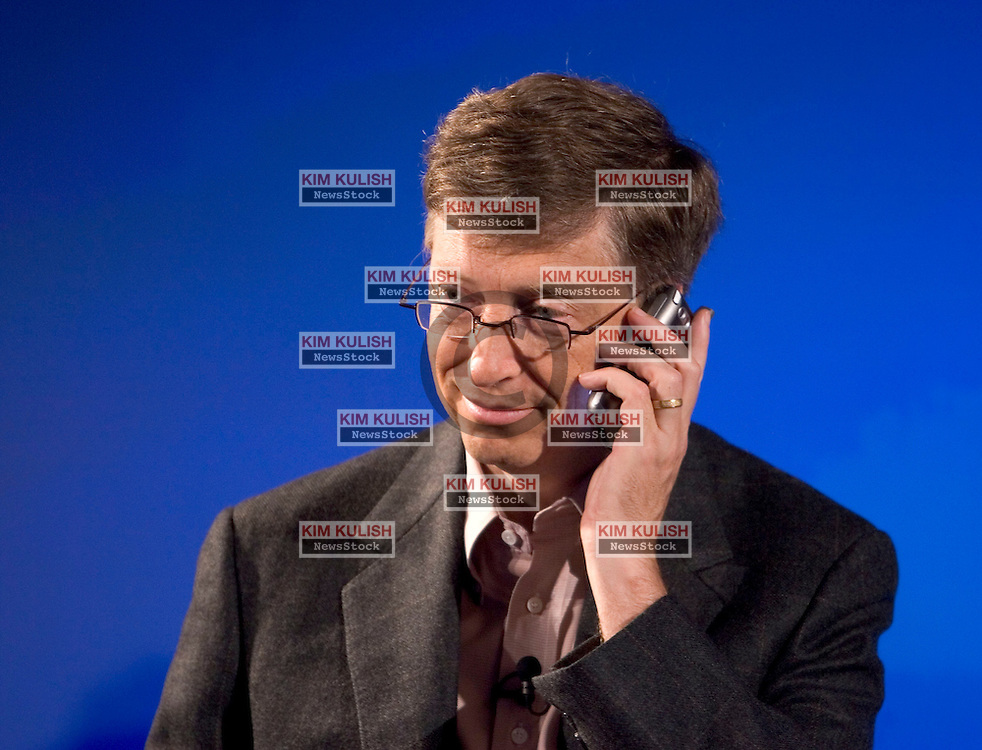 Microsoft Corporation Chairman and Chief Software Architect Bill Gates, holds a new Treo phone during a press event to   announce a strategic alliance to expand the smartphone market with a new line of Treo smartphones from Verizon Wireless national wireless broadband network at a news conference in San Francisco September 26, 2005.  Photo by Kim Kulish