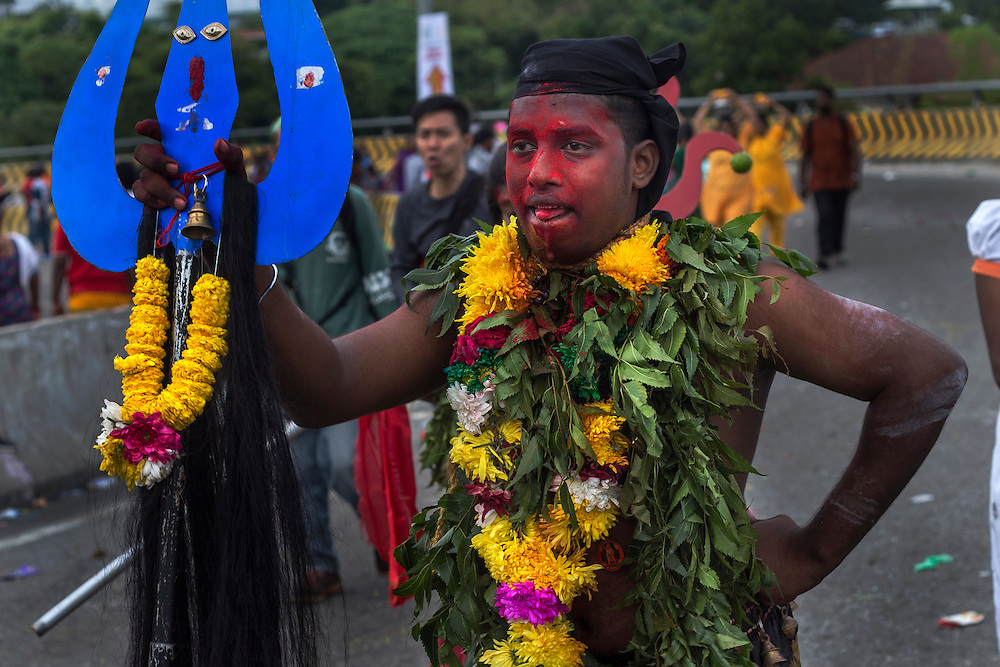 HIndu devotee in a trance as he walk to the Batu Cave temple during a Thaipusam festival in Kuala Lumpur, Malaysia, 03 Fenruary 2015.  Thousands of Hindus gather to participate in the annual Thaipusam festival dedicated to Lord Murugan. During Thaipusam day, devotees will fulfilled their vows by carrying 'kavadi (bearers had spikes pierced into their bodies) or pots of milk as offering to Lord Murugan. The devotees will make the arduous climbing up the 272 steps leading up to the temple cave and deposited at the feet of the deity to purify themselves.