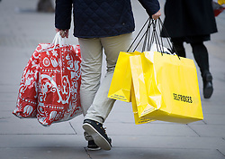 © Licensed to London News Pictures. 15/12/2011. London, UK.  Shoppers on Oxford Street, London today (15/12/2011). Data relaxed by the Office for National Statistics  shows that retail sales volumes fell 0.4% in November. Photo credit: Ben Cawthra/LNP
