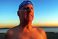 """New Year Glow"" (12/31/01 Boston, MA) Jim Doty, president of the L-street  Brownies, gets ready for the New Years Day traditional swim."