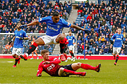Rangers Alfredo Morelos jumps the challenge from Mikael Ndjoli of Kilmarnock during the Ladbrokes Scottish Premiership match between Rangers and Kilmarnock at Ibrox, Glasgow, Scotland on 16 March 2019.