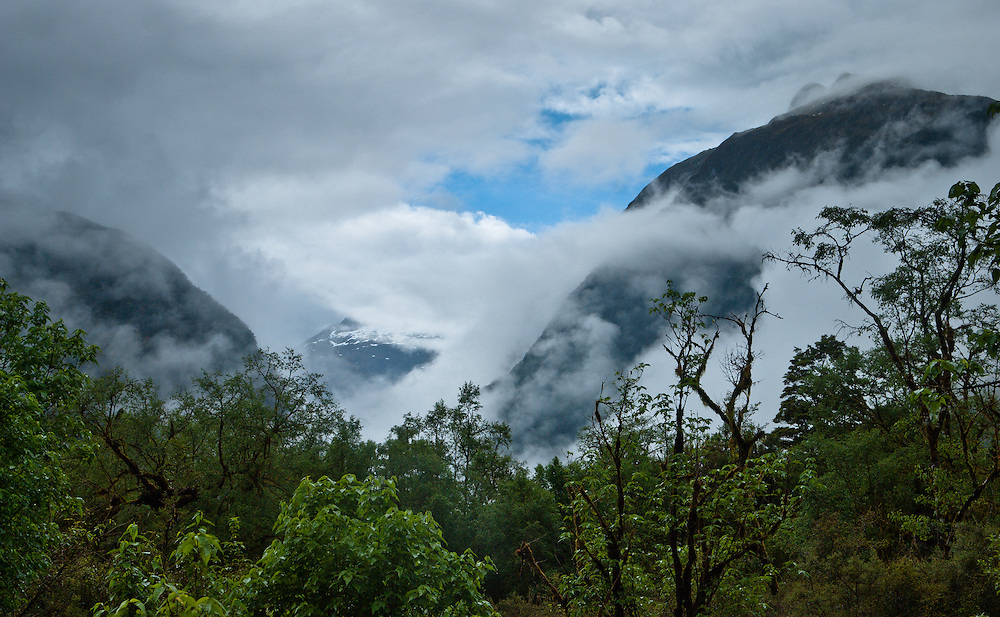 View of Mount Ada towards Lloyds Peak through lifting cloud and mist on the Milford Track, New Zealand