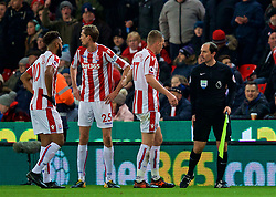 STOKE-ON-TRENT, ENGLAND - Wednesday, November 29, 2017: Stoke City players complain to the assistant referee after Liverpool score the opening goal during the FA Premier League match between Stoke City and Liverpool at the  Bet365 Stadium. (Pic by David Rawcliffe/Propaganda)