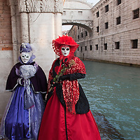 VENICE, ITALY - FEBRUARY 18:  Two women dressed with carnival costumes pose for pictures on February 18, 2012 in Venice, Italy.  The annual festival, which lasts nearly three weeks, will see the streets and canals of Venice filled with people wearing highly-decorative and imaginative carnival costumes and masks.  (Photo by Marco Secchi/Getty Images)