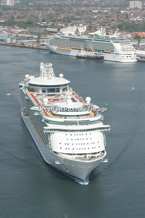 Royal Caribbean's Liberty of the Seas Passes Navigator of the Seas in Southampton Dock.