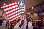 """04 JULY 2009 -- PHOENIX, AZ:  ABRAHAM GARANG, originally from the Sudan, celebrates becoming a US citizen at a naturalization ceremony in Phoenix, AZ, July 4. U.S. Citizenship and Immigration Services and South Mountain Community College in Phoenix, AZ, hosted the 21st annual """"Fiesta of Independence"""" Saturday, July 4. More than 180 people from 58 countries took the US Oath of Citizenship and became naturalized US citizens. The ceremony was one of dozens of similar ceremonies held across the US this week. USCIS said more than 6,000 people were naturalized US citizens during the week.  Photo by Jack Kurtz / ZUMA Press"""