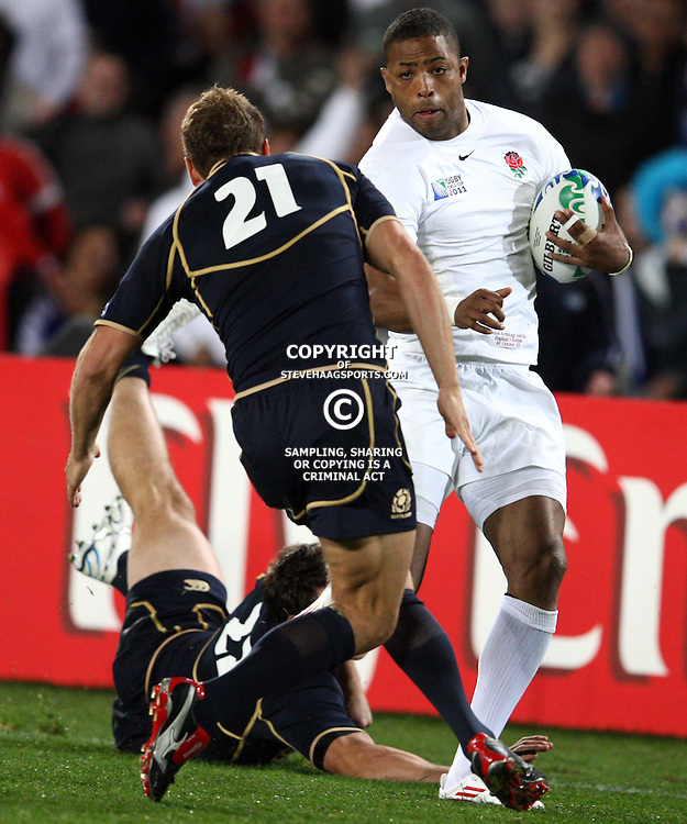 AUCKLAND, NEW ZEALAND - OCTOBER 01, Delon Armitage with a hand off on Dan Parks during the 2011 IRB Rugby World Cup match between England and Scotland at Eden Park on October 01, 2011 in Auckland, New Zealand<br /> Photo by Steve Haag / Gallo Images