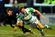 Yeovil Town's Ryan Dickson is brought down by Carlisle Utd's David Atkinson during the The FA Cup Third Round Replay match between Yeovil Town and Carlisle United at Huish Park, Yeovil, England on 19 January 2016. Photo by Graham Hunt.