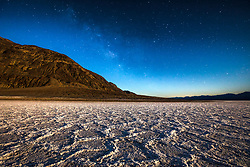 """Badwater Basin at Night 1"" - Predawn photograph of the Badwater Basin salt flat in Death Valley, California. The Milky Way can be seen in the sky."
