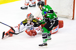 17.02.2015, Hala Tivoli, Ljubljana, SLO, EBEL, HDD Telemach Olimpija Ljubljana vs EC KAC, 4. Qualification Round, in picture Rok Leber (HDD Telemach Olimpija, #18) and Pekka Tuokkola (EC KAC, #83) during the Erste Bank Icehockey League 4. Qualification Round between HDD Telemach Olimpija Ljubljana and EC KAC at the Hala Tivoli, Ljubljana, Slovenia on 2015/02/17. Photo by Morgan Kristan / Sportida