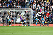 Derby County striker Darren Bent scores to put the Rams 1-1 during the Sky Bet Championship match between Derby County and Sheffield Wednesday at the iPro Stadium, Derby, England on 23 April 2016. Photo by Jon Hobley.