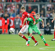 Thomas Müller of Bayern Munich and Christoph Kramer of Borussia Monchengladbach during the Bundesliga match between Bayern Munich and Borussia Monchengladbach at the Allianz Arena, Munich, Germany on 22 October 2016. Photo by Bernd Feil/pixathlon.