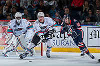 KELOWNA, CANADA - MARCH 25: Matt Revel #10 of Kamloops Blazers back checks Cal Foote #25 of Kelowna Rockets  on March 25, 2016 at Prospera Place in Kelowna, British Columbia, Canada.  (Photo by Marissa Baecker/Shoot the Breeze)  *** Local Caption *** Cal Foote; Matt Revel;