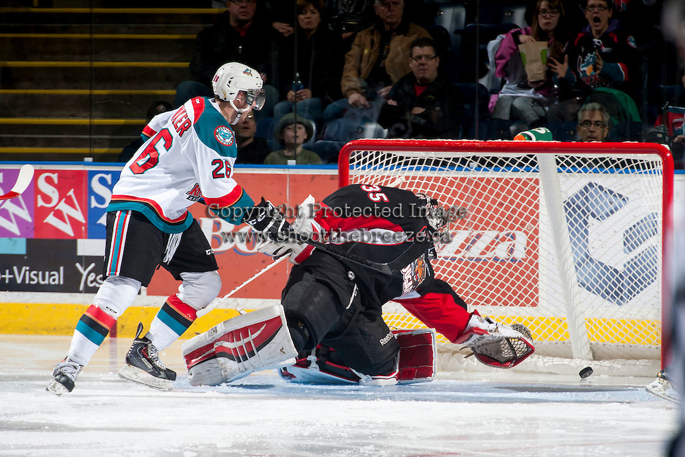 KELOWNA, CANADA - DECEMBER 30: Ty Edmonds #35 of Prince George Cougars misses a save against the Kelowna Rockets on December 30, 2014 at Prospera Place in Kelowna, British Columbia, Canada.  (Photo by Marissa Baecker/Shoot the Breeze)  *** Local Caption *** Ty Edmonds;