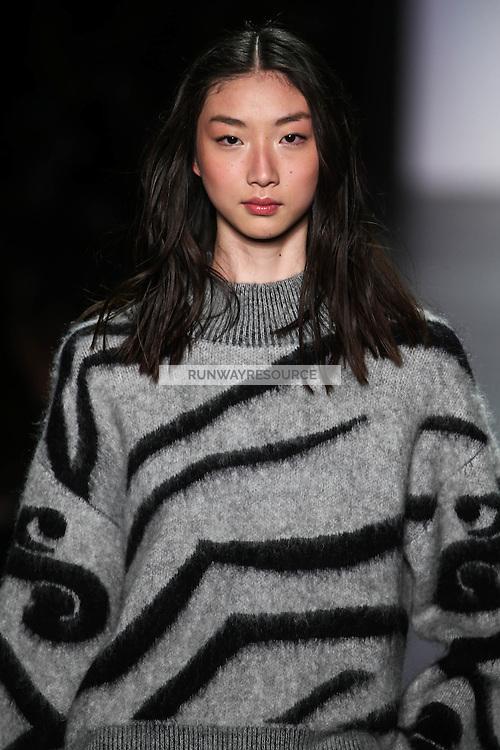 Yue Ning walks the runway wearing Vivienne Tam Fall 2016 during New York Fashion Week on February 15, 2016