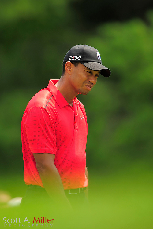 Tiger Woods reacts to a shot during the final round of the AT&T National at Congressional Country Club on July 1, 2012 in Bethesda, Maryland. ..©2012 Scott A. Miller