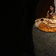 Heather Hamm sits dressed as Belle Sunday December 7, 2014 during Aniwave 2014 at the Wilmington Convention Center in Wilmington, N.C. (Jason A. Frizzelle)