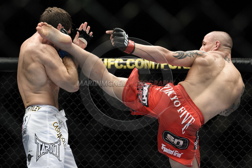 """MANCHESTER, ENGLAND, NOVEMBER 14, 2009: Aaron Riley (left) and Ross Pearson during """"UFC 105: Couture vs. Vera"""" inside the MEN Arena in Manchester, United Kingdom."""